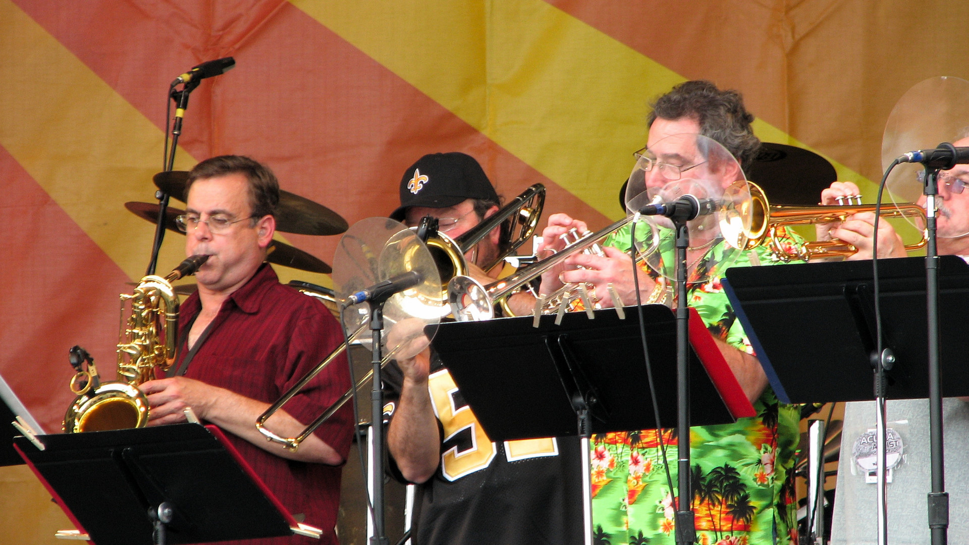 Ward Smith on sax, Mike Genevay on trombone, and trumpeters Jimmy Weber and A. J. Pittman
