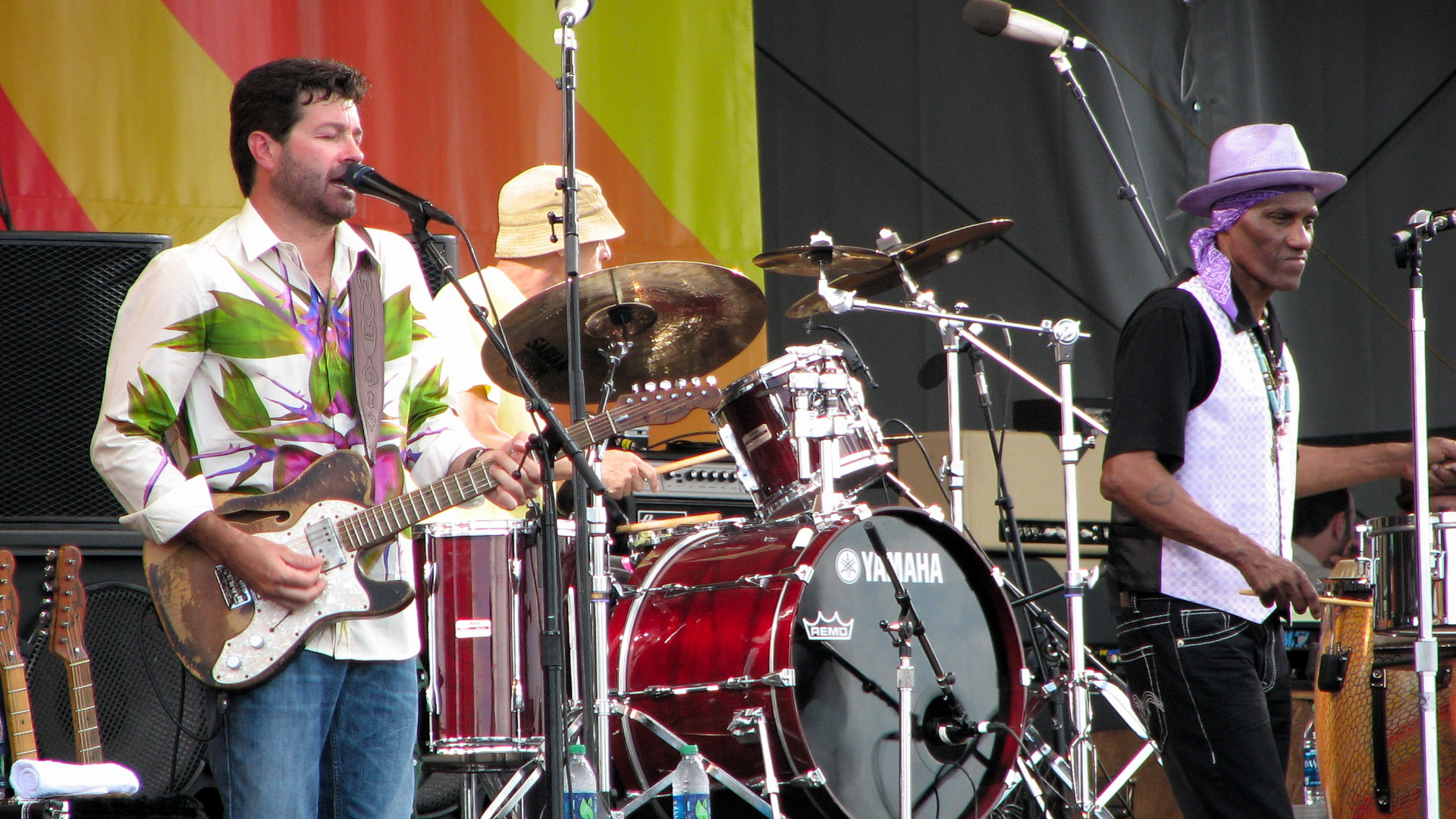 Tab Benoit on guitar, Johnny Vidacovich on drums, and Cyrille Neville, percussion and vocals