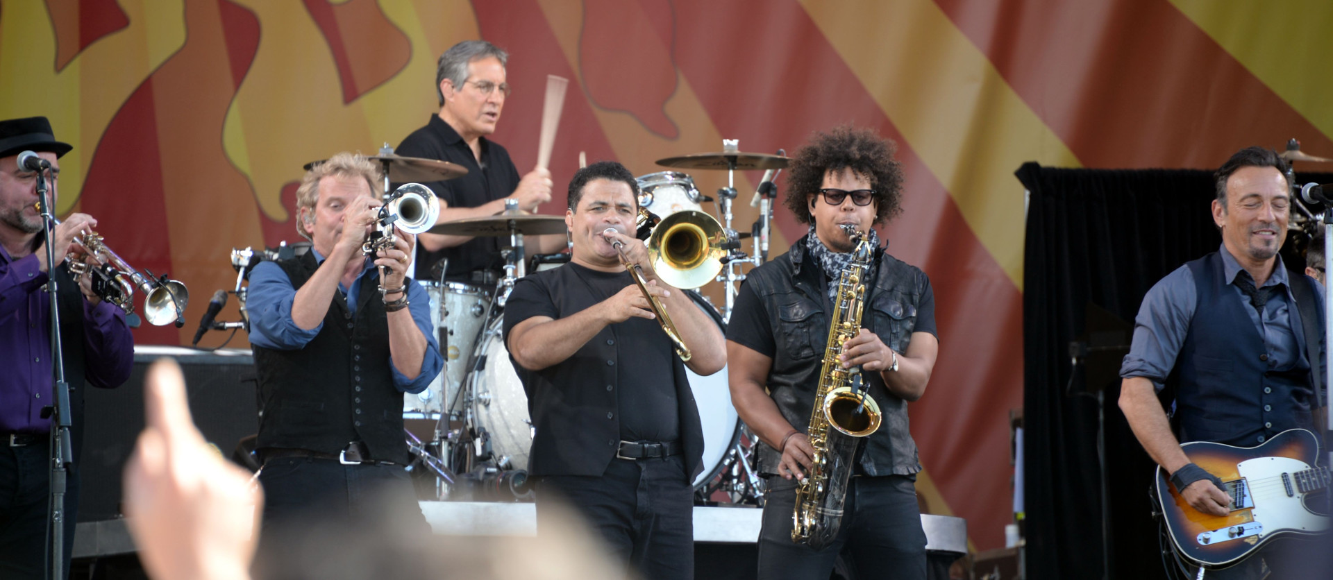 Max Weinberg on drums, fronted by the E Street horns, and Bruce
